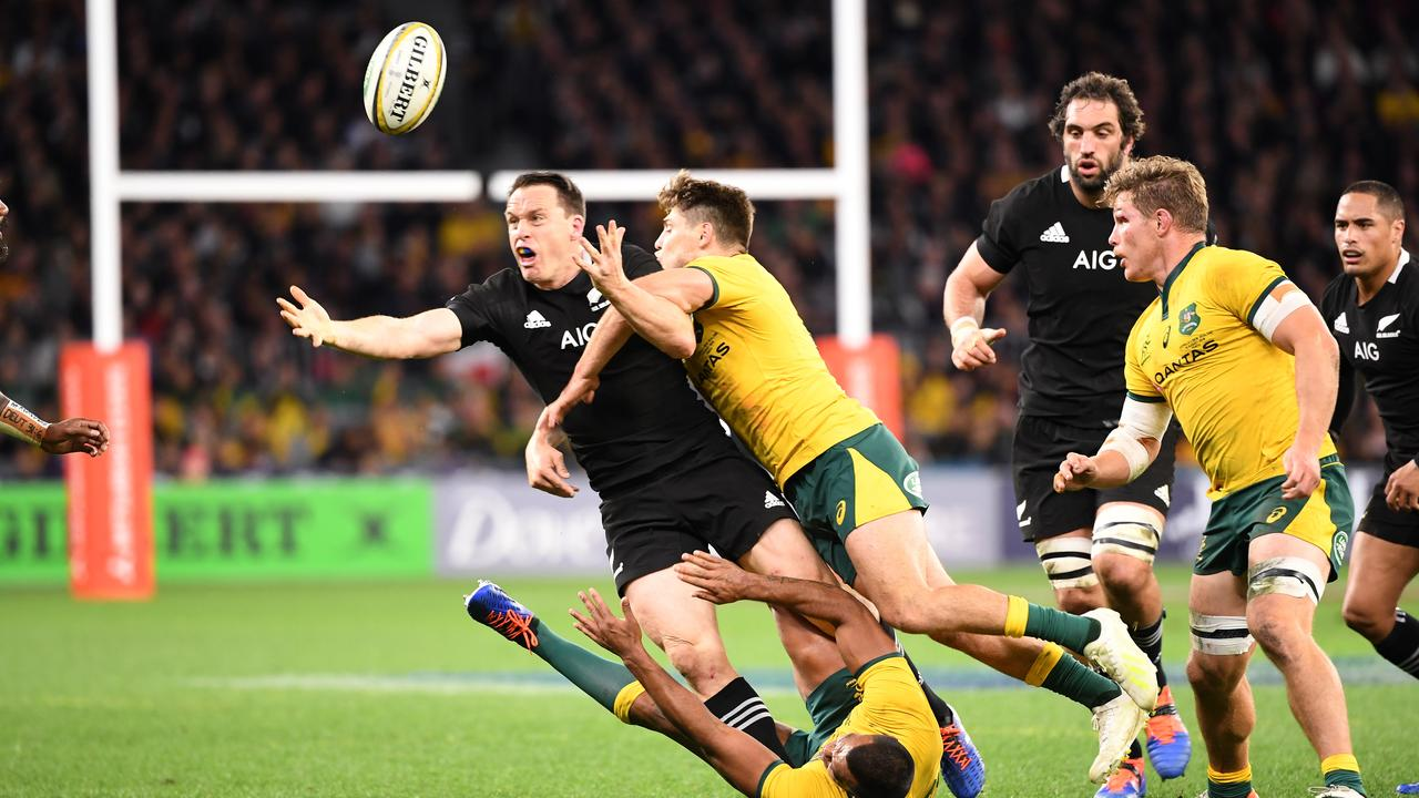 James O'Connor of the Wallabies tackles Ben Smith of the All Blacks.