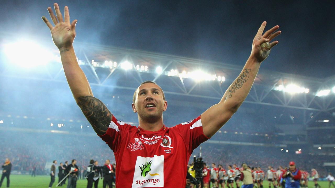 Quade Cooper of the Reds acknowledges the crowd after winning the 2011 final.