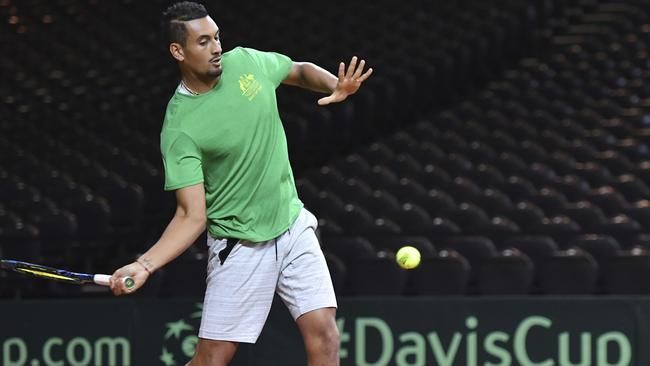 Nick Kyrgios returns the ball during a practice session prior to Australia's Davis Cup semi against Belgium.