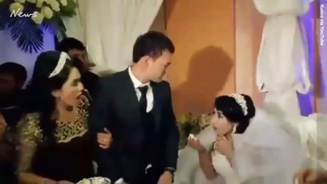'Disgusting' moment bride is slapped by groom