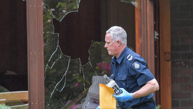 Police and forensics at the Harkaway home. Picture: Jason Edwards