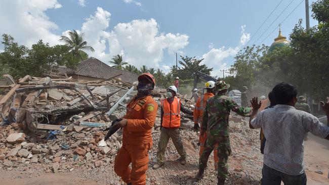Not again: Indonesian search and rescue members react shortly after an aftershock hits the area in Tanjung on Lombok island on Thursday. Picture: Adek Berry/AFP