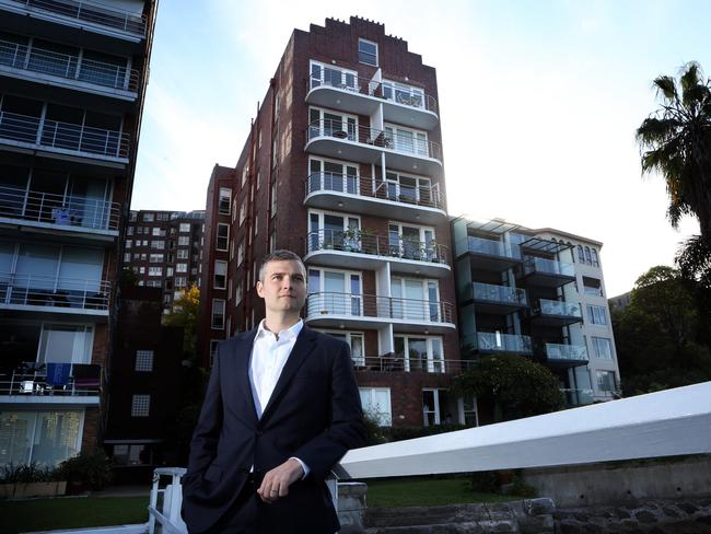 Real Estate agent Charlie Mortimer outside the apartment building in Elizabeth Bay, where a 50 sqm roof cavity apartment has sold for $1m. Picture: by James Croucher