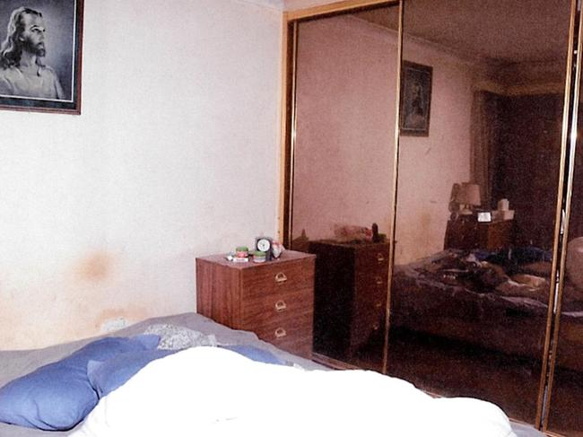 A triage nurse said the 72-year-old in her bedroom (above) had a wound on her bottom 'the size of my fist'.