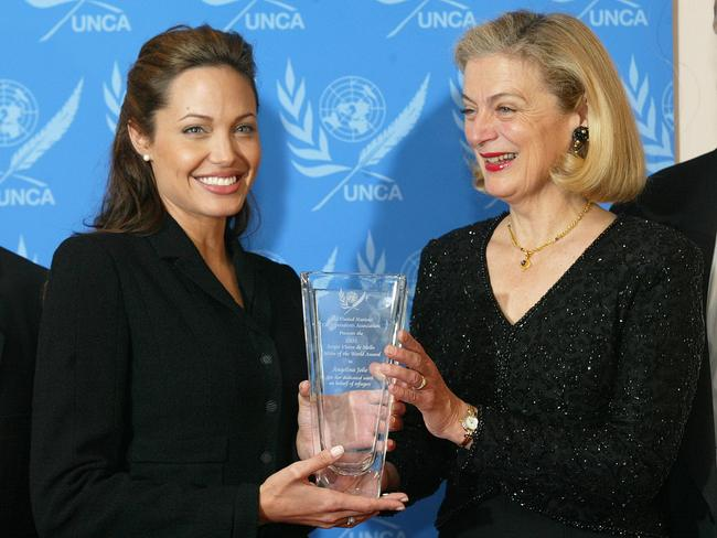 Angelina Jolie receiving her United Nations Correspondents Association Citizen of the World award from Nane Annan. Picture: AP