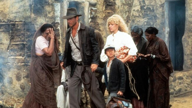 Harrison Ford, Jonathan Ke Quan and Kate Capshaw are led through a temple in a scene from the movie. Picture: Paramount/Getty Images