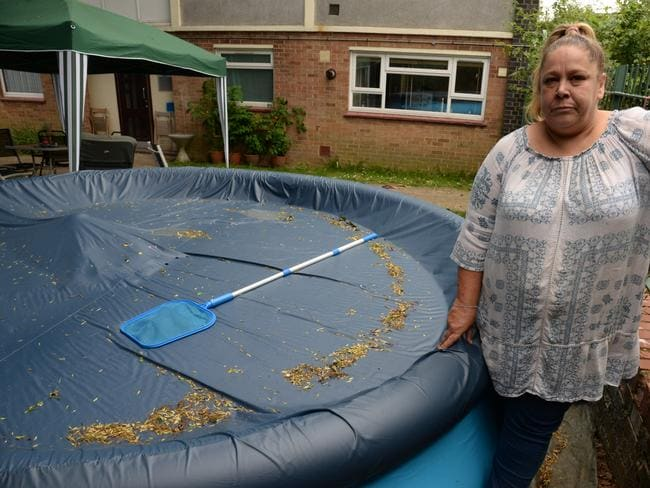 The paddling pool brought relief to residents suffering in the heat. Picture: SWNS/Mega