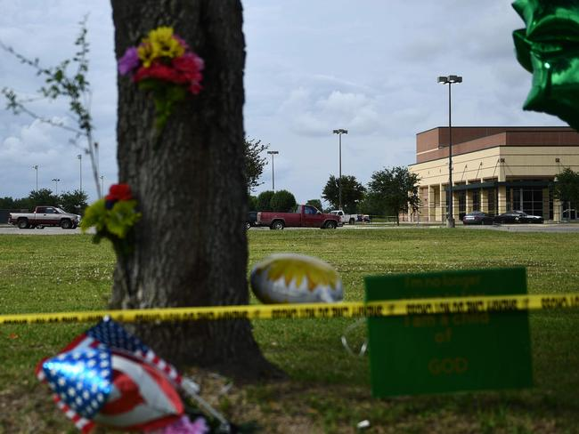 Memorials are posted outside the Santa Fe High School, after the deadly attack that killed 10 people and injured more than a dozen.Picture: Brendan Smialowski/AFP
