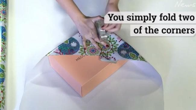 Start with two adjacent corners and hold in place