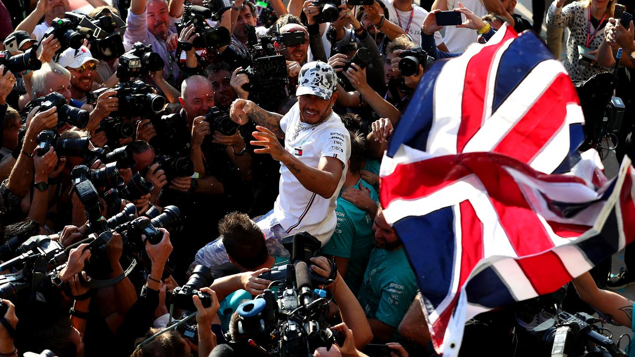 Hamilton is mobbed by photographers after the race. Picture: Mark Thompson