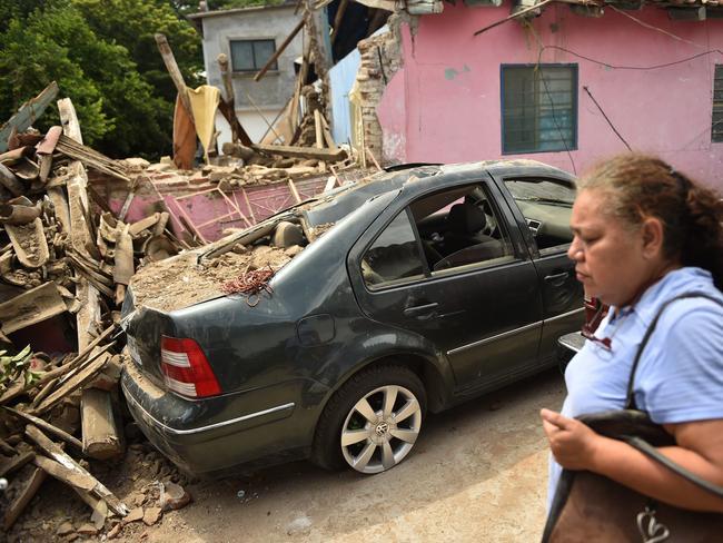 A woman walks along a street in Juchitan de Zaragoza, state of Oaxaca, where buildings collapsed. Picture: AFP