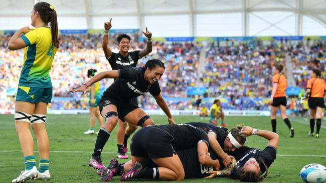 New Zealand's Kelly Brazier is congratulated by team mates after scoring the winning try in the Women's Gold Medal Rugby Sevens Match. Picture: Getty