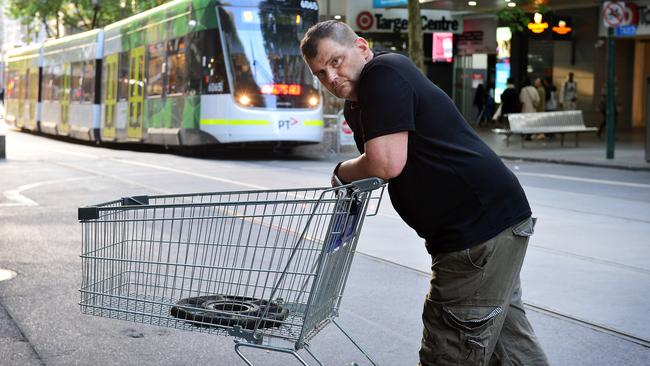 Mr Rogers didn't want to comment further when approached by the Sunday Herald Sun but agreed to pose for this photo with the trolley he used to fend off a terrorist. Picture: Nicki Connolly.
