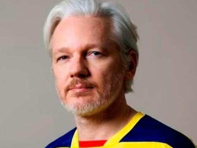 Julian Assange wearing an Ecuador football top inside the Embassy where he has been for five years.