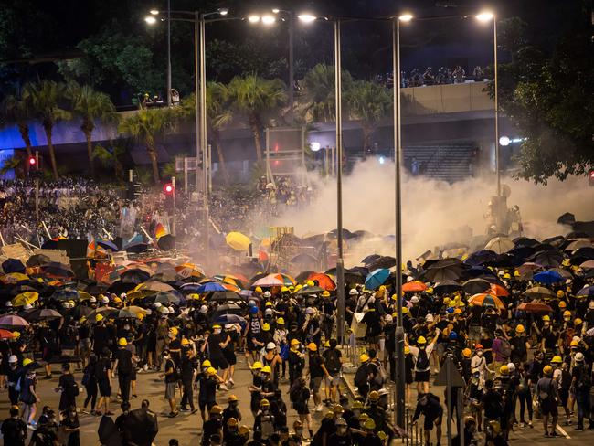 Police fire tear gas as they charge toward thousands of pro-Democracy protesters outside the Legislative Council Complex on July 2, 2019 in Hong Kong, China. Picture: Billy H.C. Kwok/Getty Images