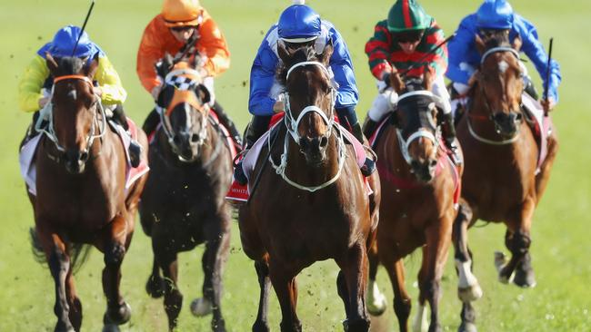 Winx hits the overdrive button to annihilate her rivals at Royal Randwick. Picture: Getty Images