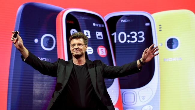 "HMD global CEO Arto Nummela presents his company's new phone ""Nokia 3310"" during a press conference on the eve of the start of the Mobile World Congress. AFP PHOTO / Josep Lago"