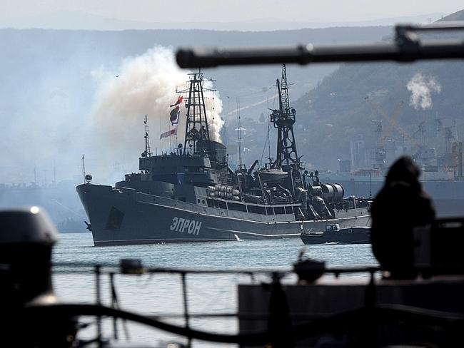 Standoff ... a Russian Navy ship sails in front of a Ukrainian miltary ship on Sevastopol bay. Picture: VIKTOR DRACHEV