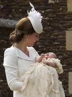 Catherine, Duchess of Cambridge, carries Princess Charlotte of Cambridge as they arrive at the Church of St Mary Magdalene on the Sandringham Estate for the Christening of Princess Charlotte of Cambridge on July 5, 2015 in King's Lynn, England. Picture: Getty