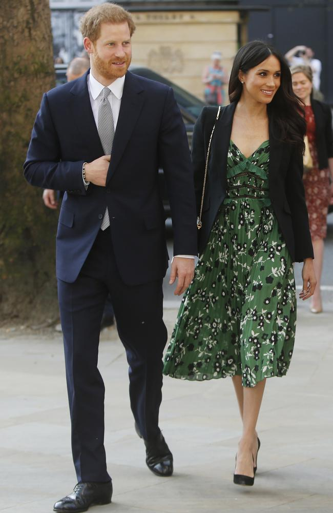 Meghan stuns in a $550 Self-Portrait frock that has already sold out.