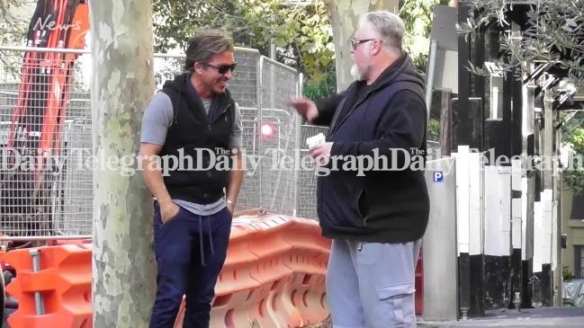 John Ibrahim and Kyle Sandilands laugh after police raid