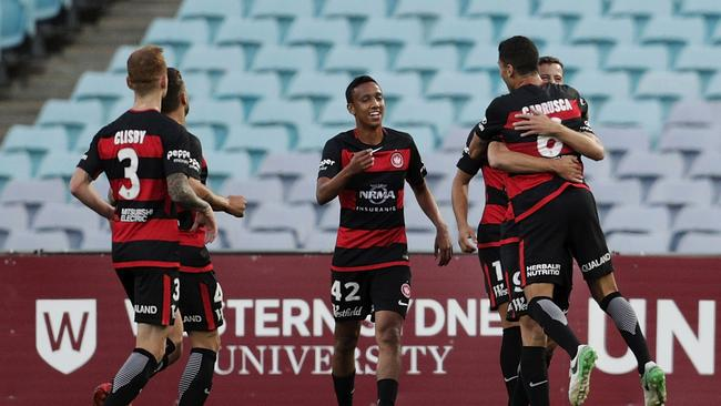 Western Sydney Wanderers players celebrate a goal