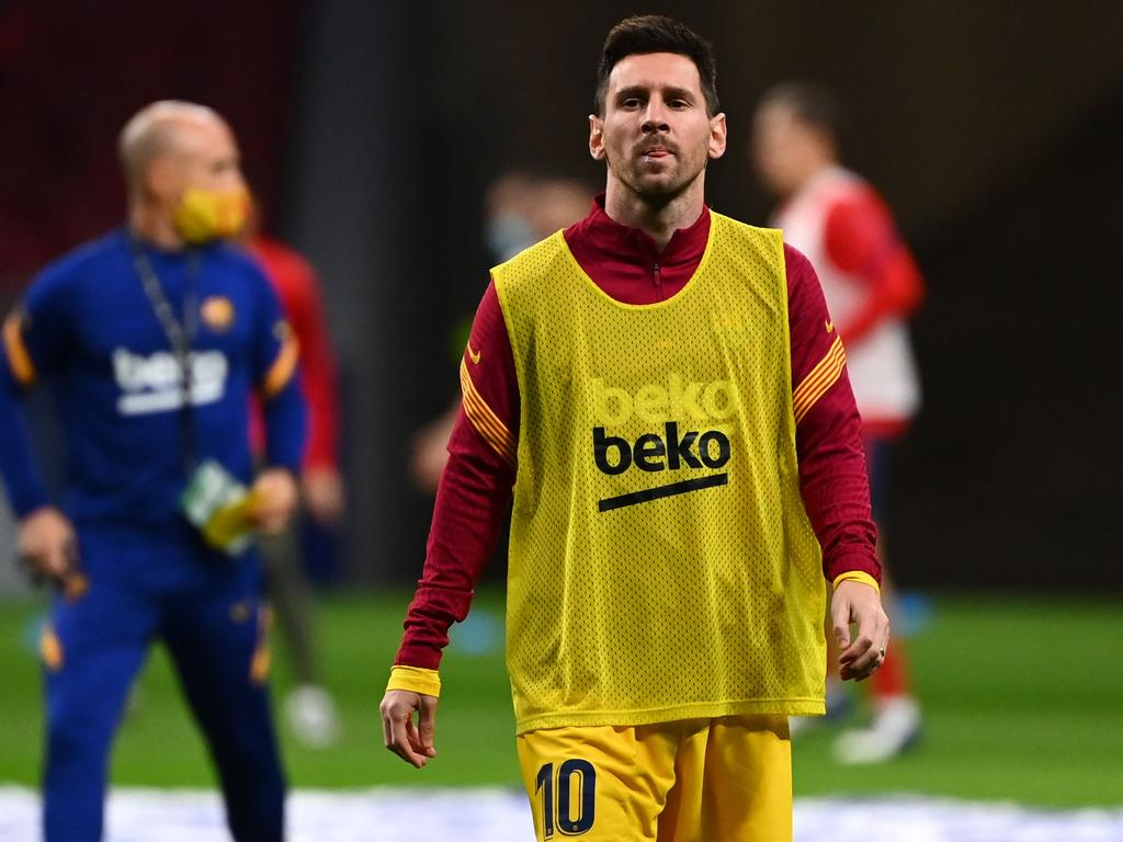 Barcelona's Argentine forward Lionel Messi warms up before the Spanish League football match between Club Atletico de Madrid and FC Barcelona at the Wanda Metropolitano stadium in Madrid on November 21, 2020. (Photo by GABRIEL BOUYS / AFP)