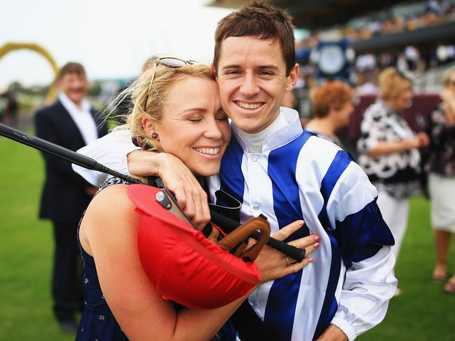 Jockey Jason Collett with partner and trainer Clare Cunningham.