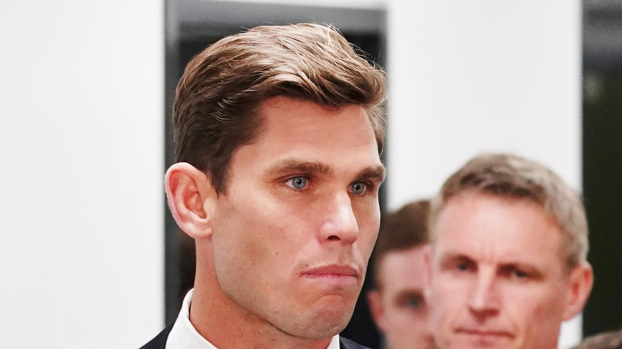 Tom Hawkins looks on after leaving the tribunal in September.