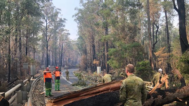 Fallen trees are blocking the only road out of Mallacoota. Picture: Department of Defence