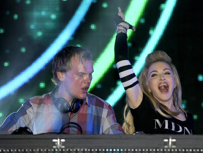 Avicii onstage with Madonna in 2012. Picture: Tim Mosenfelder/Getty Images