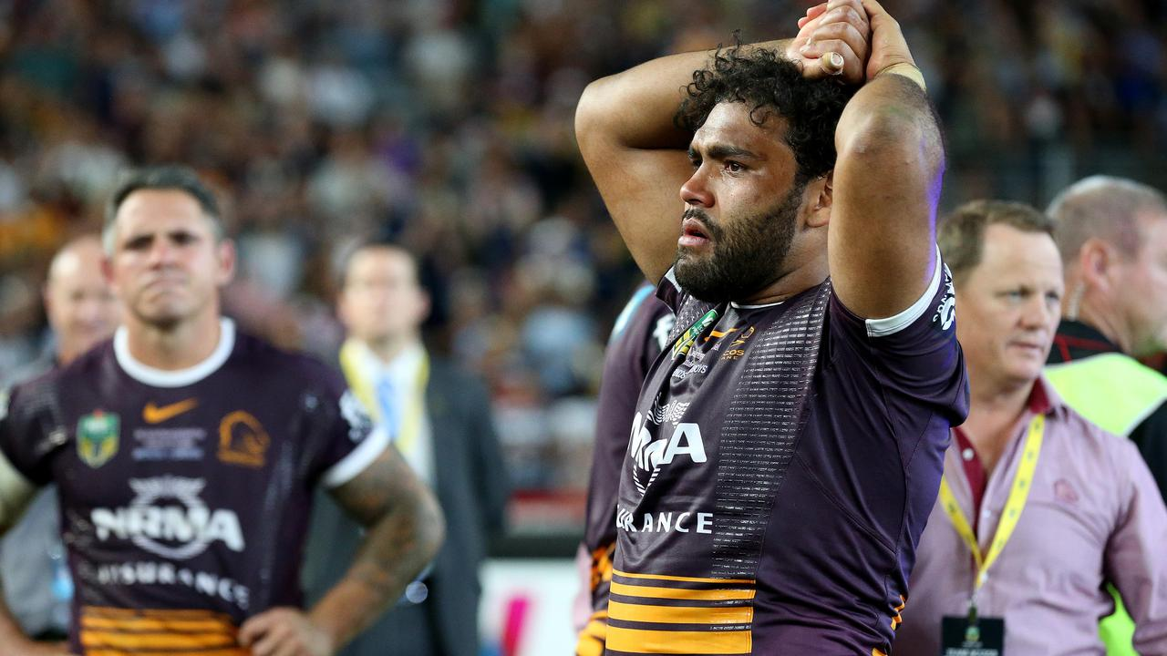 Sam Thaiday and Corey parker digest defeat in the 2015 Grand Final.