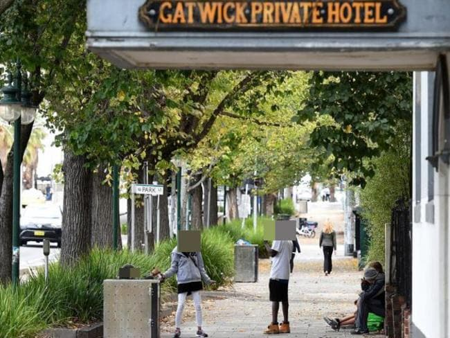 People gather on the footpath outside the Gatwick Hotel in St Kilda, Melbourne which is due to shut down. Picture: Mal Fairclough