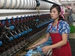 A women works in Kim Jong Suk Silk Factory. Picture: Carl Court/Getty Images