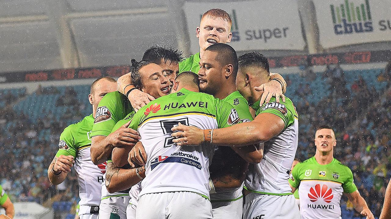 Joseph Leilua of the Raiders (centre) celebrates after scoring a try against the Titans.
