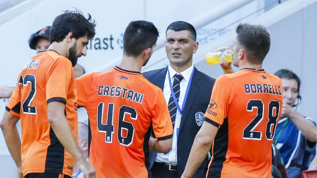 Brisbane Roar Head Coach John Aloisi with his players.