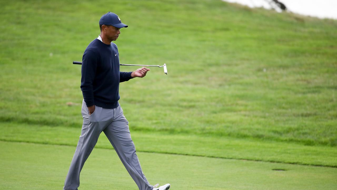 Tiger Woods narrowly avoided the cut.