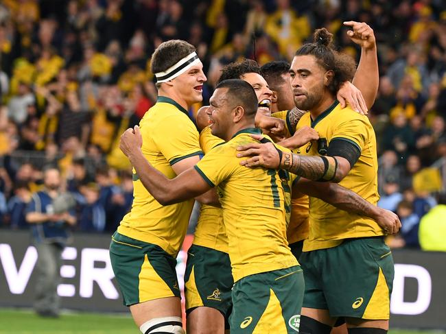 The Wallabies celebrate during their historic victory.
