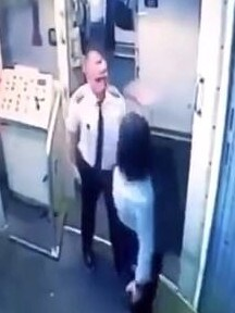 The woman slaps the man after he appears to spit in her direction.