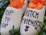 A pair of clogs with a message for Dutch citizens killed on the Malaysia Airlines flight MH17 is seen in front of the Netherlands Embassy in Washington, DC. Picture: AFP