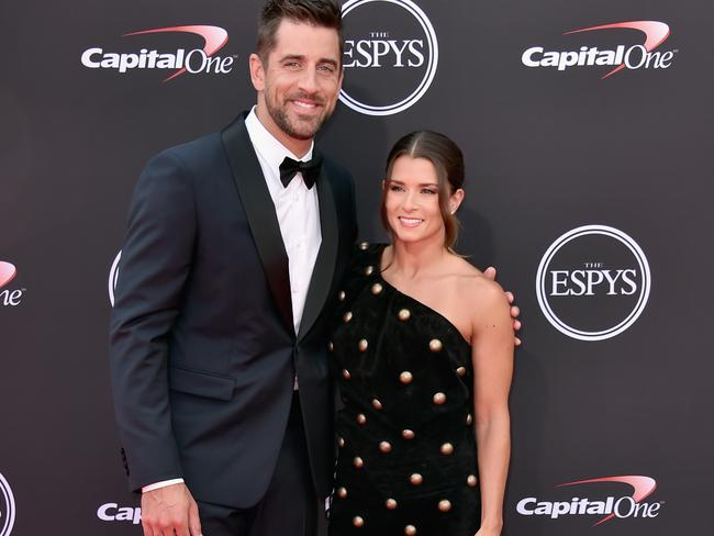 NFL player Aaron Rodgers and host Danica Patrick.