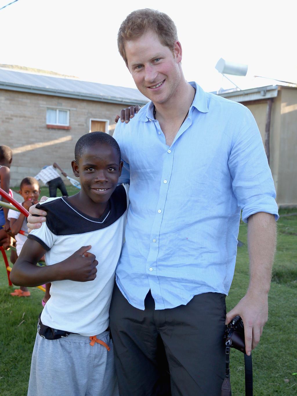 Prince Harry reunites with orphan pen pal Mutsu Potsane
