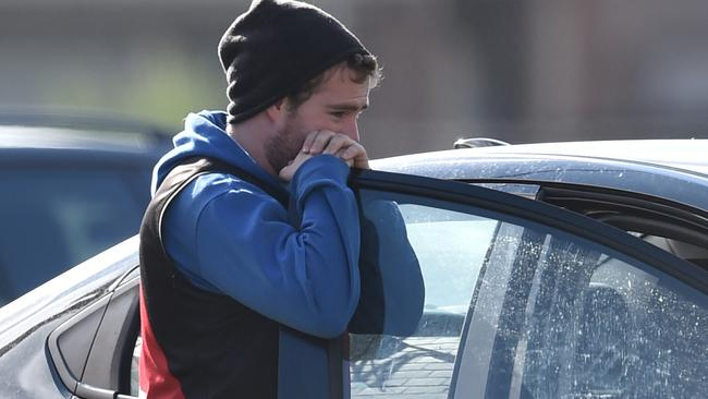 An Essendon Football club supporter reacts to the CAS decision. Picture: AAP Image/Julian Smith