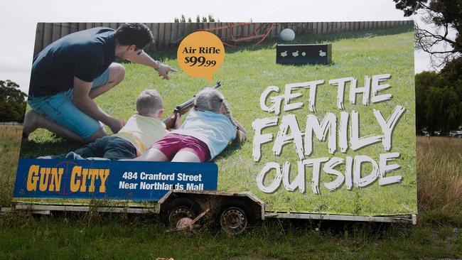 An advertisement for the Gun City store that has reportedly upset locals is seen on the outskirts of Christchurch. Picture: Marty Melville / AFP