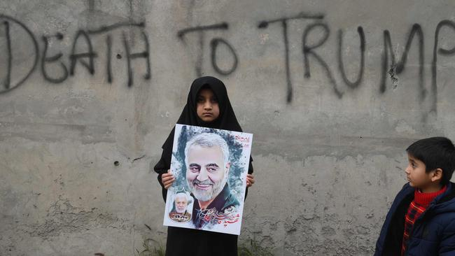 A Shiite Muslim girl in Lahore holds a poster of Iranian commander Qasem Soleimani as she takes part in a anti-US protest against his killing, on January 12. Picture: Arif Ali/AFP