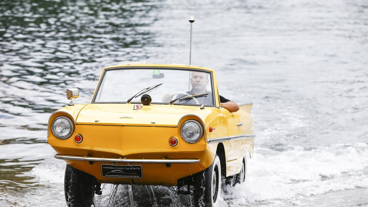 Jason Fischer driving the 1966 Amphicar 770. Picture: Dylan Robinson