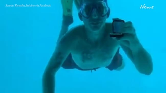 Final moments of man proposing to girlfriend underwater caught on camera