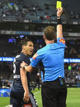 Mark Milligan wasn't impressed when referee Peter Green pulled out a yellow card.