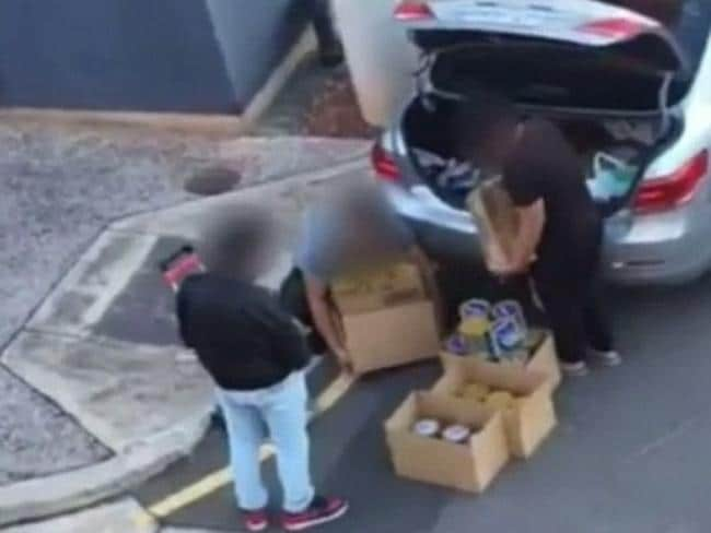 Three men were seen packing a car with baby formula at Mawson Lakes in Adelaide. Picture: Nine News