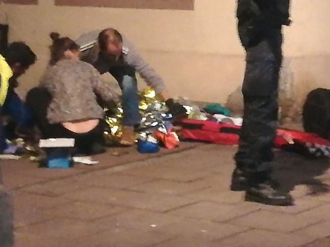 Rescuers treating an injured person in the streets of Strasbourg, eastern France. Picture: AFP